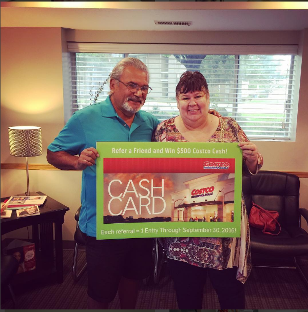 Marjean and Dennis winning the $500 Costco Gift Card